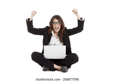 Excited woman with arms up winning online - isolated over white