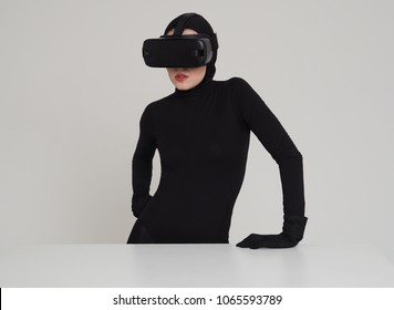 An excited woman experiencing the virtual reality helmet. Hi-Tech gadgets for geeks and technical enthusiasts. Virtual reality helmet for entertainment.
