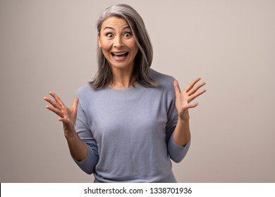 Excited Woman With Grey Hair Actively Gestures. Happy Middle-Aged Woman Gesturing In Excitement. Portrait.