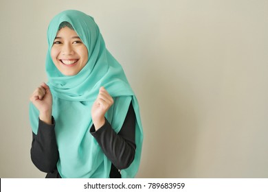 excited woman with hijab, happy girl in headscarf smiles, excited islam asian girl, muslim woman isolated; excited girl face with head scarf; islamic woman portrait; asian girl young adult woman model