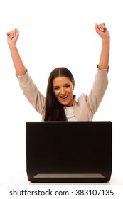 Excited woman looking into laptop computer with high raised hands happy of success.