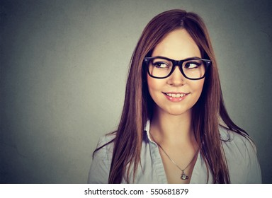 Excited woman looking sideways smiling. Closeup of happy mixed race female business woman isolated on gray background