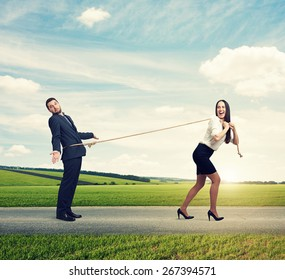 excited woman lugging man on the road