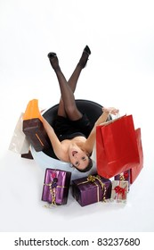 Excited woman sat with shopping bags