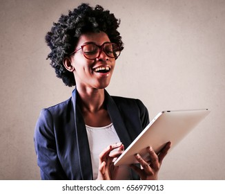 Excited woman using a tablet
