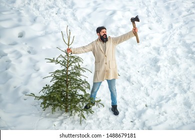 Excited woodsman with Christmas tree. Winter portrait of lumber in snow Garden cutting Christmas tree. Happy winter time