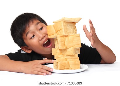 excited young boy with bread