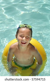 Excited young boy in a pool