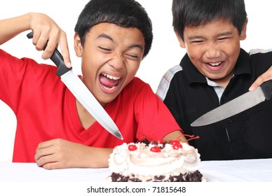 Excited young boys ready to slice a cake