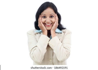 Excited young business woman against white background
