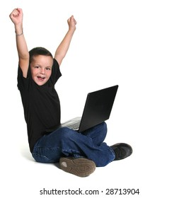 Excited Young Child Working on Computer With Arms Up in Excitement