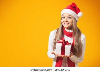 Excited young girl with x-mas gift box posing