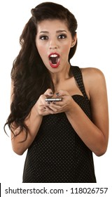 Excited young Latino woman holding cell phone over white