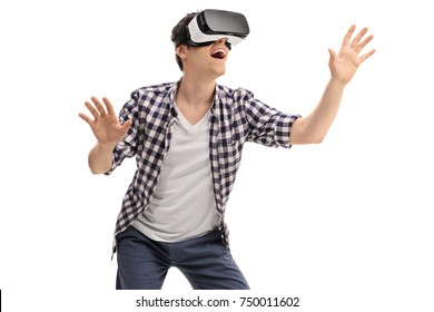 Excited young man experiencing virtual reality isolated on white background