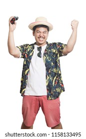Excited young man in hawaiian costume received travel on white background.