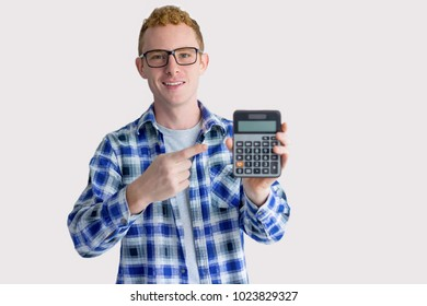 Excited Young Man Pointing at Calculator Screen