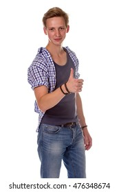 Excited young man showing the thumbs up gesture, on isolated background.