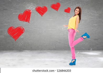 excited young woman being in love, standing on one leg