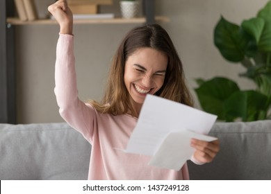 Excited young woman hold paper letter feel euphoric receiving job promotion or tax refund from bank, happy girl reading paperwork document smiling of good pleasant news, getting student scholarship