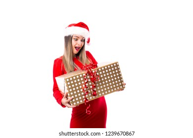 Excited young woman holding a big present over white. Christmas time.