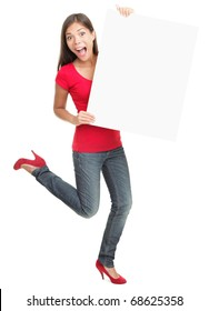 Excited young woman holding empty white board isolated on white background.