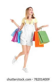 Excited young woman with shopping bags on white background