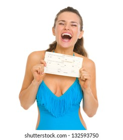 Excited young woman in swimsuit holding air tickets