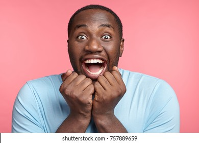 Excitement and amazement. Positive male says wow, stares at camera with eyes full of happiness, finds out about winning present in lottery, can`t believe his good luck, being excited and stunned