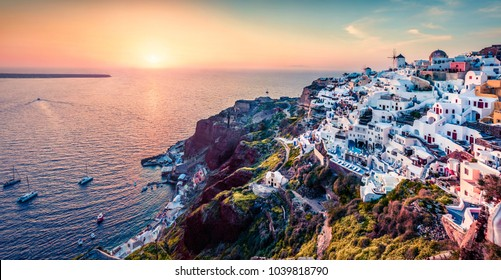 Exciting evening view of Santorini island. Picturesque spring sunset on the famous Greek resort Oia, Greece, Europe. Traveling concept background. Artistic style post processed photo.