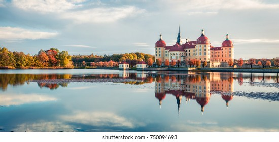 Exciting morning panorama of Moritzburg Baroque palace surrounded by a lake. Great autumn sunrise in Saxony, Dresden location, Germany, Europe. Traveling concept background.