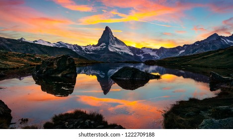 Exciting morning view of Stellisee lake with Matterhorn/Cervino peak on background. Unbelievable autumn scene of Swiss Alps, Zermatt location, Switzerland, Europe. Beauty of nature concept background.