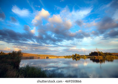 exciting summer landscape white clouds reflected in the mirror water quiet river