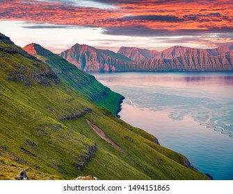 Exciting summer sunset on Faroe Islands, Denmark, Europe. Last sunlight glowing mountain ridge. Beauty of nature concept background.