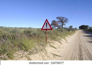 Exclamation. Enigmatic roadsign on a dirt track in the kalahari desert