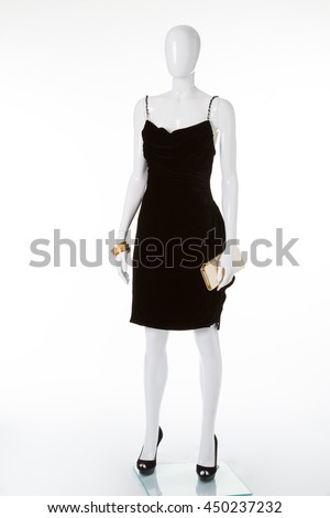 Exclusive black dress on a white mannequin. The classic black dress.  Evening cocktail dresses ddd4b4bfaf9