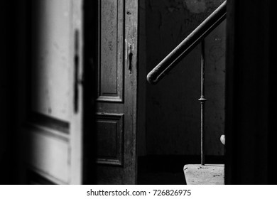 Exclusive black and white interior design. Abandoned old house. Details of vintage interior. Atmosphere of loneliness and solitude. House of no return. Feelings of depression.