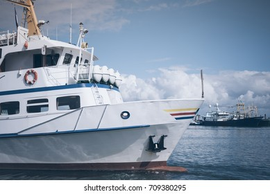excursion boat in a harbor on the Island of Sylt, Germany under blue sky