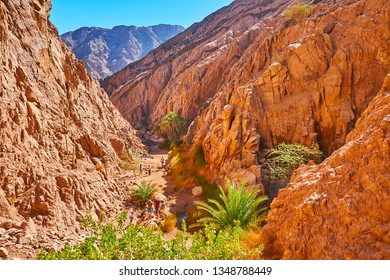 Excursions to the canyons of Sinai are popular attractions in Egyptian resorts, tourists get experience of visiting Small Colored canyon, located next to Dahab, Sinai, Egypt.