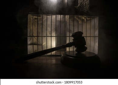 Execution with Lethal injection concept. Death penalty lethal injection table miniature inside old prison. Old prison bars cell lock. Creative artwork decoration. Old grunge prison interior.
