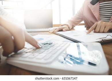 executive analysis on data paper with accountant using calculator at the office, business concept