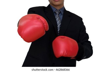 executive businessman fight in business concept with red hand glove for show his power isolated with path