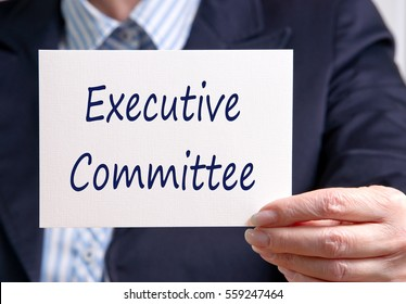 Executive Committee - business person with sign and text