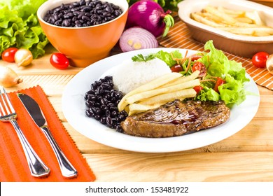 Executive dish: Grilled, rice and beans.