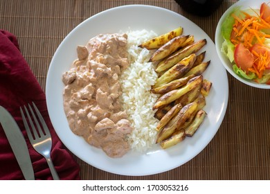 executive dish of stroganoff with fries