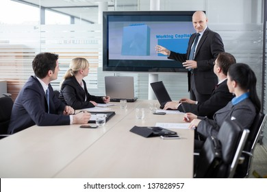 Executive explaining business plans to his employees