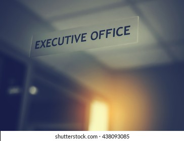 Executive office signed on the mirror door, conceptual