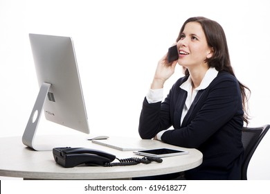 Executive on her computer talking on the phone