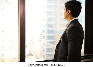 executive professional businessman wear suit is smart standing in font of window glass, look forward or vision concept