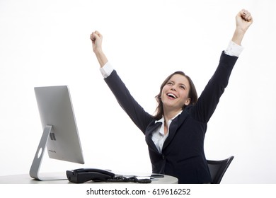 Executive raises her arms in sign of triumph