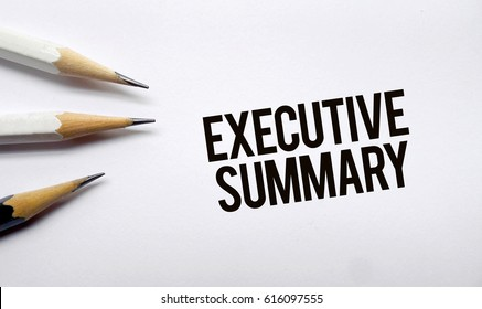 Executive summary memo written on a white background with pencils
